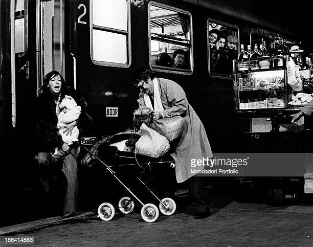 Swedishborn Italian actor Lou Castel and Italian actress Mariangela Melato getting off a train in the film Caro Michele Italy 1975