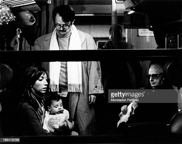 Swedishborn Italian actor Lou Castel and Italian actress Mariangela Melato sitting in a train carriage in the film Caro Michele Italy 1975