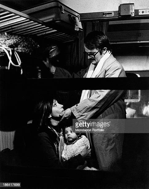 Swedishborn Italian actor Lou Castel caressing Italian actress Mariangela Melato seated in a train carriage in the film Caro Michele Italy 1975