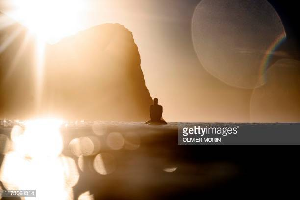 TOPSHOT Swedish's surfer Robert Kleiven waits for a wave in Unstad Lofoten Islands beyond the Arctic Circle on September 26 during the Longboard...