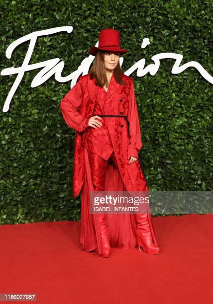 Sweedish actress Noomi Rapace poses on the red carpet upon arrival at The Fashion Awards 2019 in London on December 2 2019 The Fashion Awards are an...