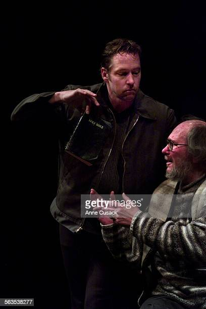 DB Sweeney who plays Montag temps Jay Gerber sho plays Professor Faber with a book by waving it in front of him Ray Bradbury's Pandemonium Theatre...