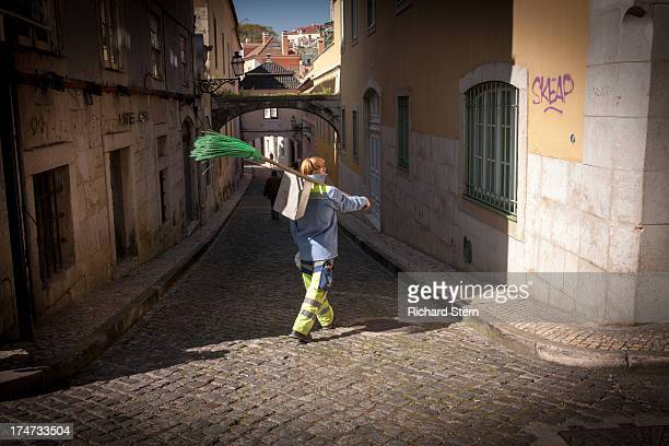 Sweeper cleaner lady woman street cleaner in Lisbon, Portugal broom brush occupation hygiene