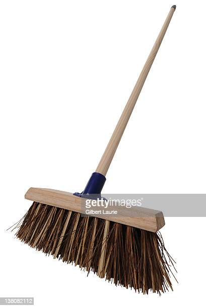 Sweeping broom on white background