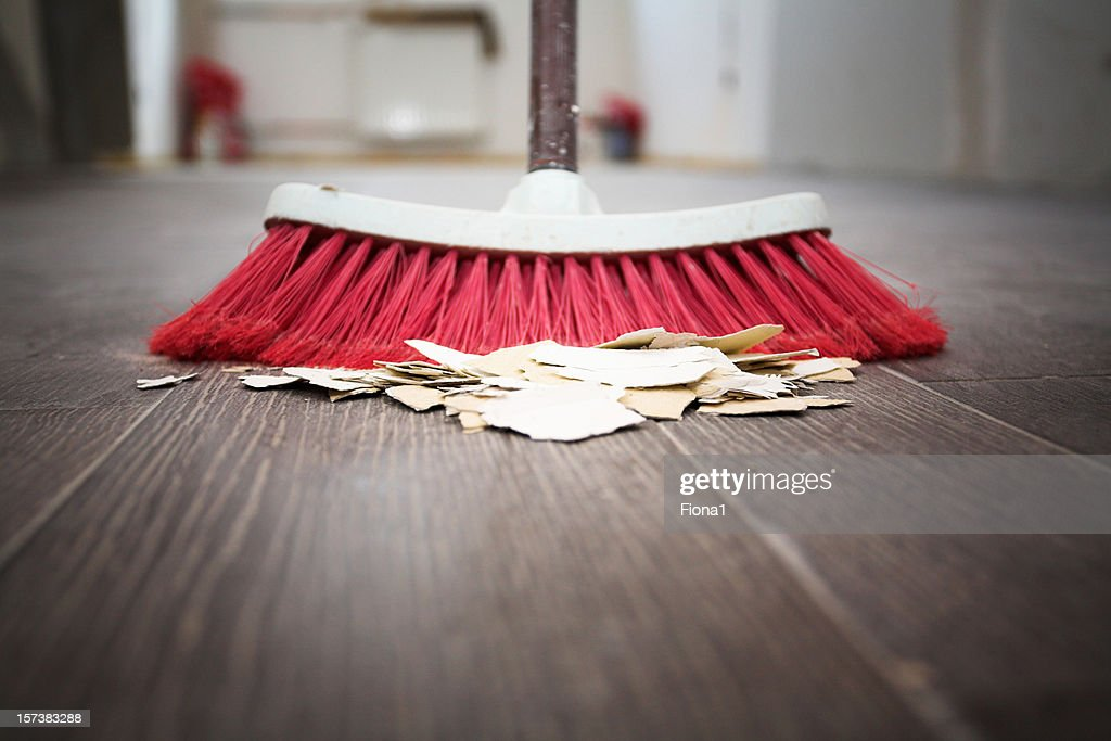 sweeping floor with broom high res stock photo getty images https www gettyimages com detail photo sweeping floor with broom royalty free image 157383288