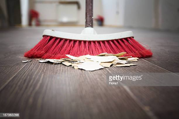 Sweeping floor with broom