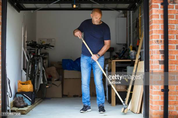 sweeping his garage floor - sweeping stock pictures, royalty-free photos & images