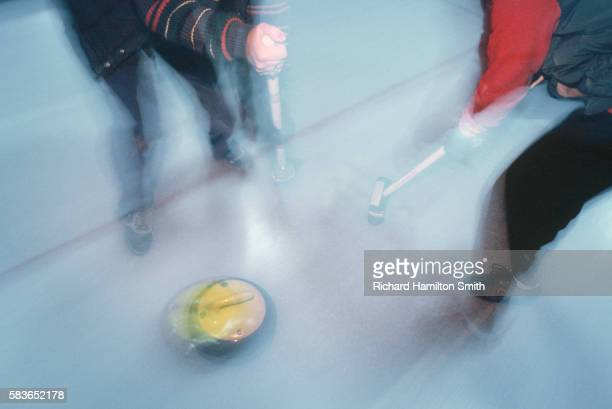 Sweeping in Front of Curling Stone