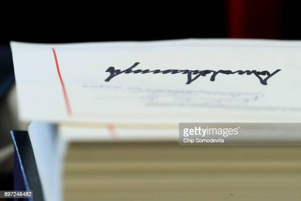 Sweeping new tax reform legislation bears US President Donald Trump's signature in the Oval Office at the White House December 22 2017 in Washington...
