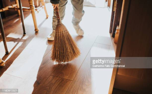 sweeping - broom sweeping stock pictures, royalty-free photos & images