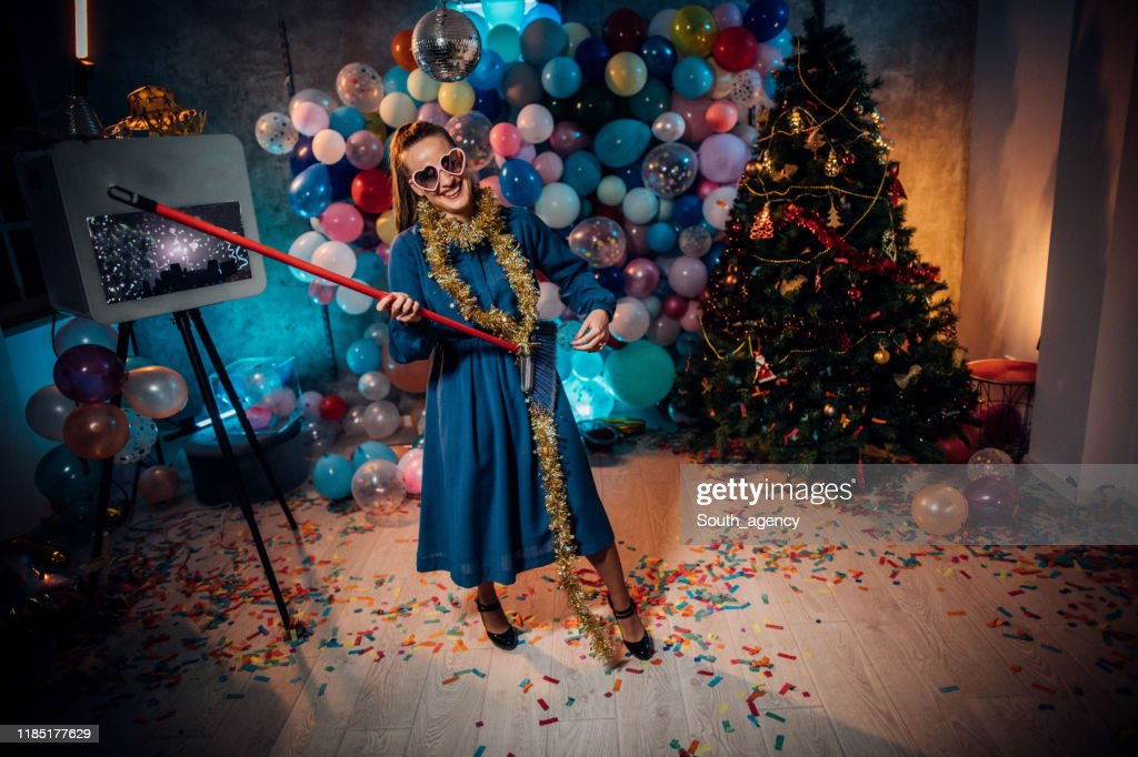 Sweeping the house after new year party : Stock Photo