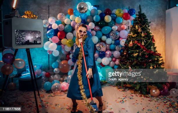 sweeping the house after new year party - clean up after party stock pictures, royalty-free photos & images