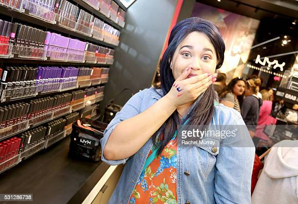 Sweepstakes Winner Jasmine Jackson playfully show off her lipstick color swatch picks at the NYX Beauty Bar during the NYX Professional makeup store...