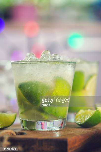 sweet and refreshing drink caipirinha cocktail - vodka stock pictures, royalty-free photos & images