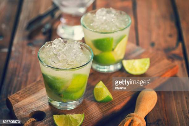 sweet and refreshing drink caipirinha cocktail - refreshment stock pictures, royalty-free photos & images