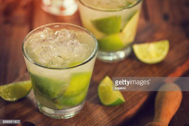 sweet and refreshing drink caipirinha cocktail - crushed ice stock pictures, royalty-free photos & images
