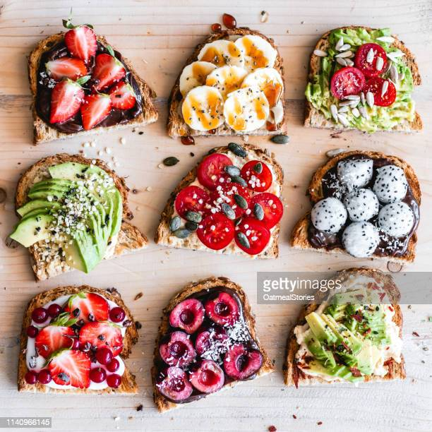 sweet and savory toasts with fruit and vegetables - pane integrale foto e immagini stock