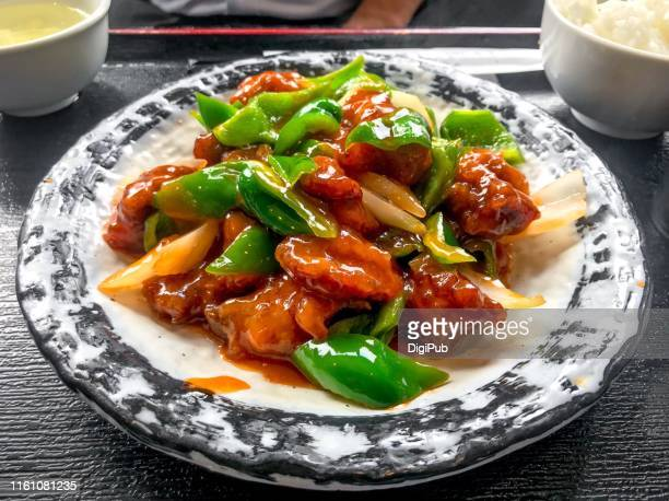 sweet and sour pork served at lunchtime in yokohama - green bell pepper stock pictures, royalty-free photos & images