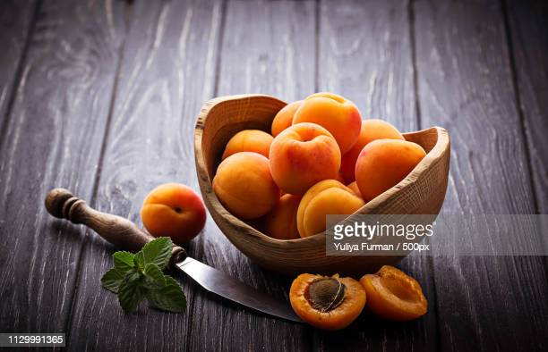 sweet apricots on wooden background - apricot stock pictures, royalty-free photos & images