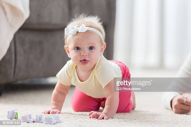 Sweet baby girl crawls on the floor