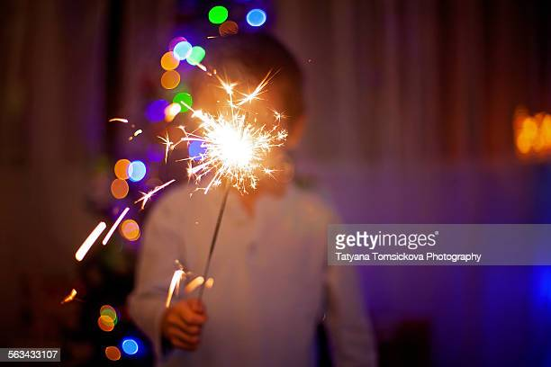 Sweet boy, holding sparkler