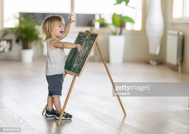 sweet boy with blackboard