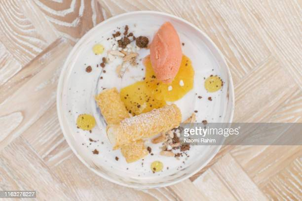 sweet cannoli and pastel-colored sorbet dessert, seen directly above on a white-washed timber table - herringbone floor stock photos and pictures