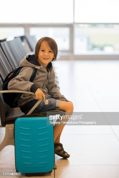sweet child, boy, waiting at the airport, carrying suitcases and backpacks, family holiday - toddler at airport stock pictures, royalty-free photos & images