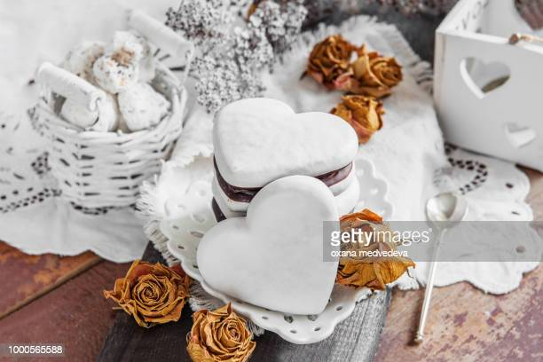 Sweet cookies in the form of hearts from gingerbread dough chocolate and a white glaze....