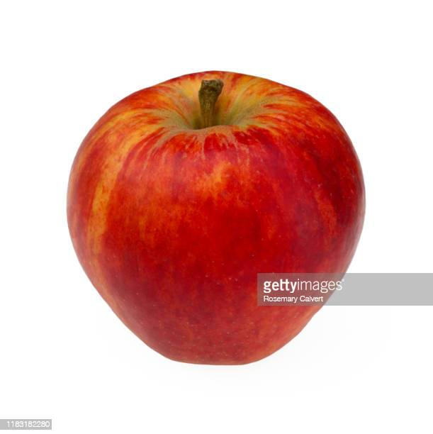 sweet & crisp organic rubens apple, a civni apple cultivar. - silhouette stock pictures, royalty-free photos & images