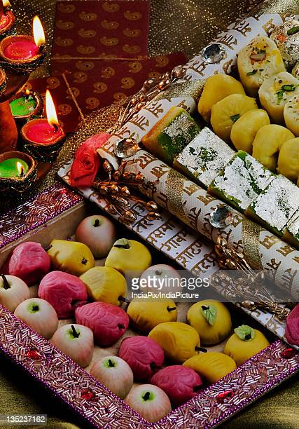 sweet dishes and diyas - diwali sweets stock photos and pictures
