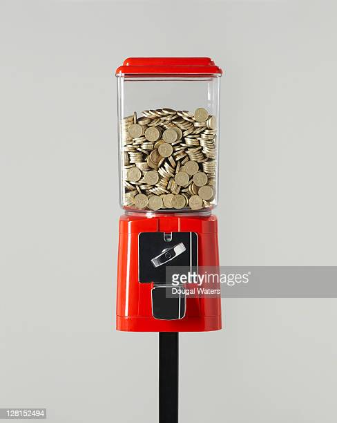 Sweet dispenser full of coins.