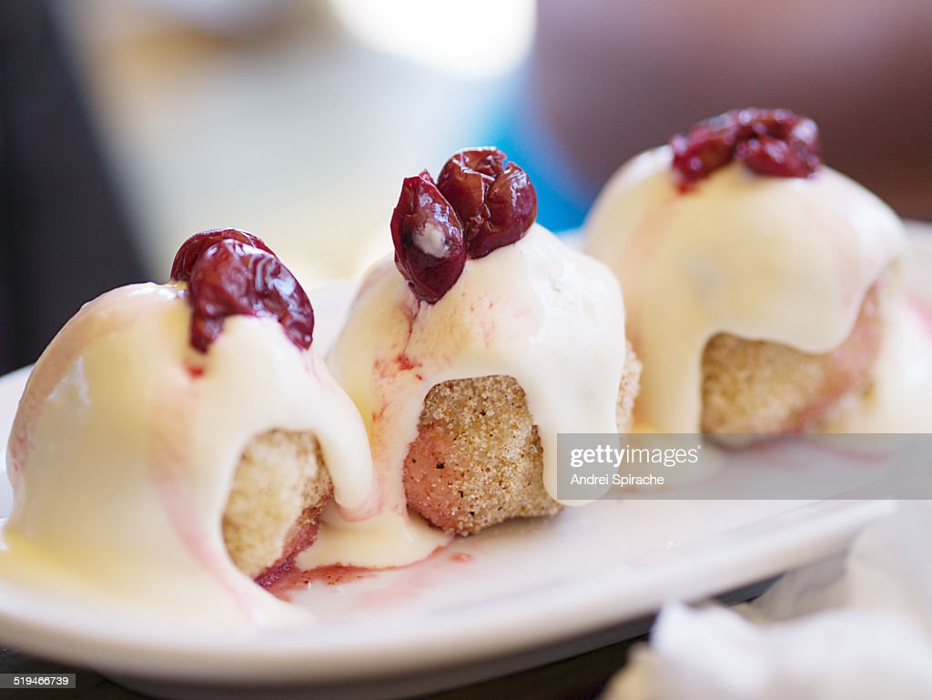 Sweet dumplings with sour cream and sour cherries : Stock Photo