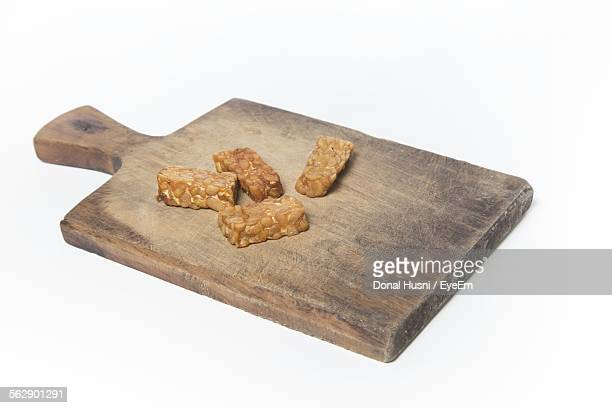 Sweet Food On Cutting Board Against White Background