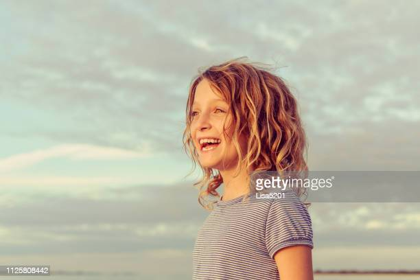 sweet girl at dusk, golden glow at golden hour - hope stock pictures, royalty-free photos & images