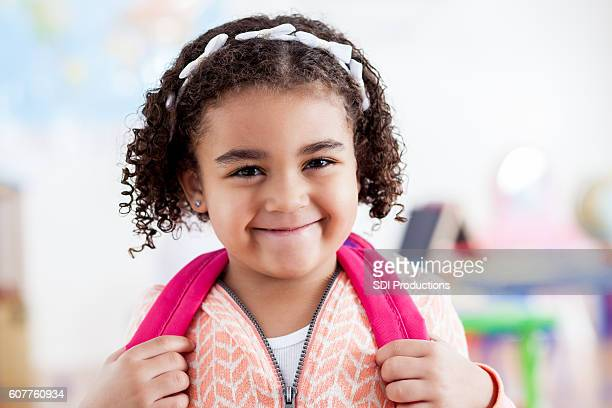 Sweet girl in her preschool classroom