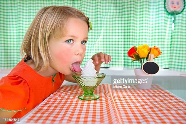 Sweet girl licking an ice-cream