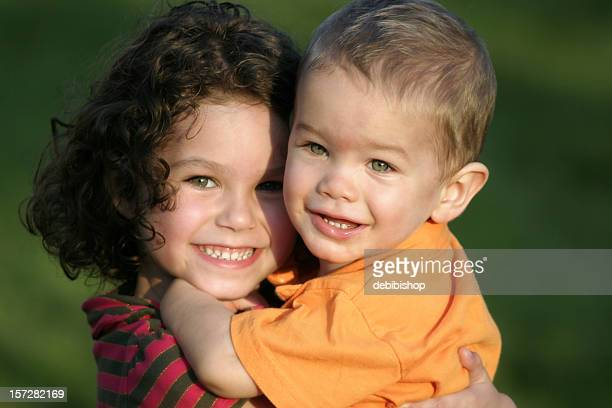 Sweet Happy Siblings - Brother and Sister Hugging