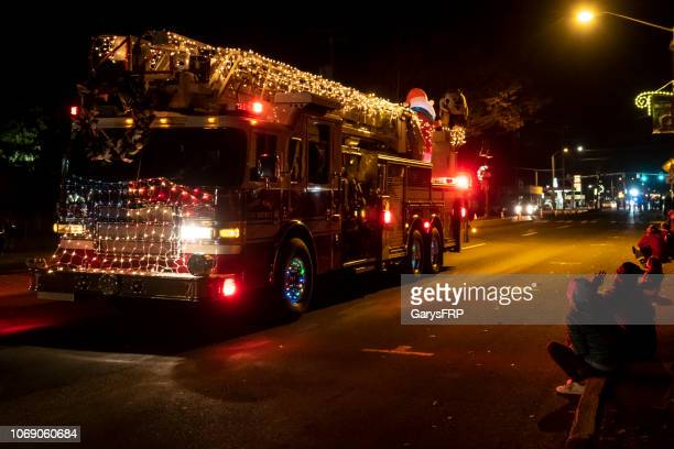 sweet home capitol christmas tree celebration lighted parade fire truck - patriotic christmas stock pictures, royalty-free photos & images