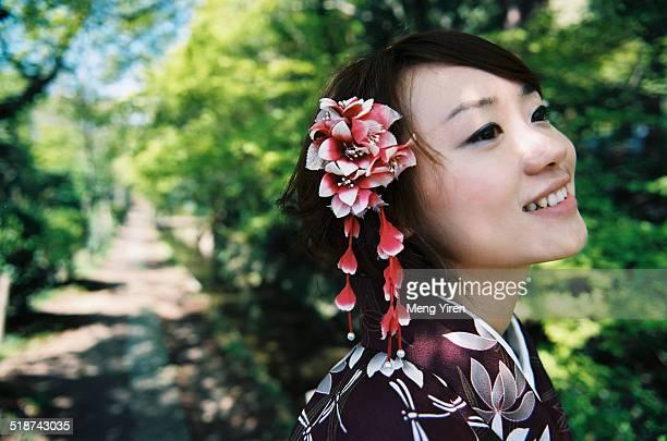 Sweet lady with smile in kimono