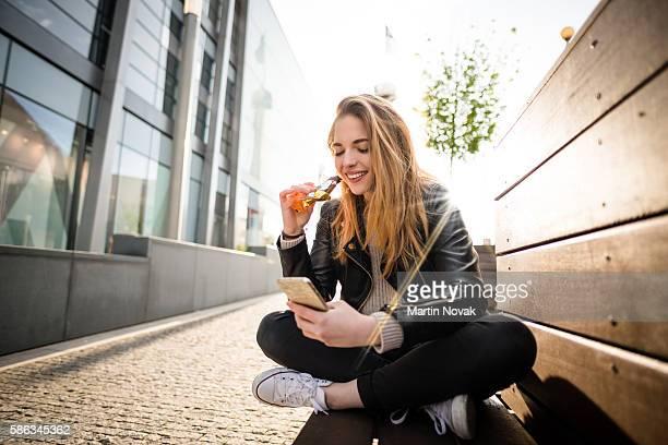 sweet life - woman in street - barra de chocolate imagens e fotografias de stock