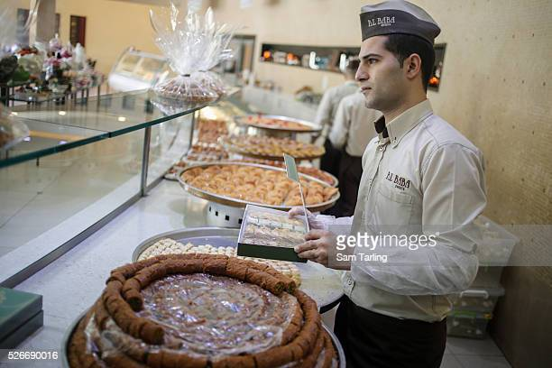 A sweet makers in Saida Lebanon on July 16 2013 A perennial favourite for special occasions and tourist gifts Lebanese baklava maamoul and other...