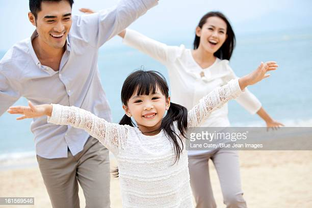 Sweet moment among young family on the beach of Repulse Bay, Hong Kong