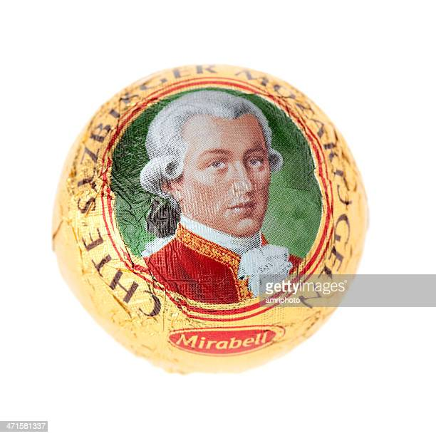 sweet mozartkugel isolated on white - wolfgang amadeus mozart stock pictures, royalty-free photos & images
