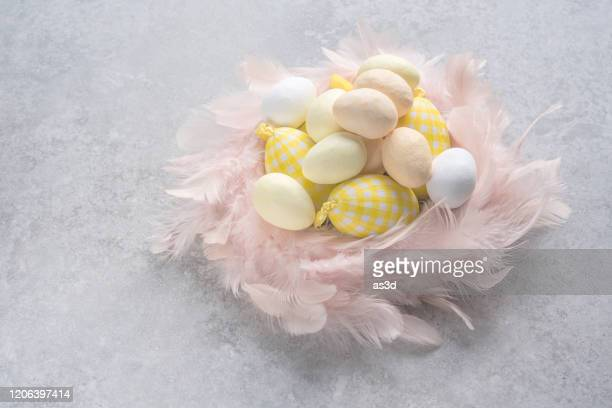 sweet pastel colored easter eggs in pink nest - easter religious background stock pictures, royalty-free photos & images