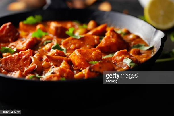 sweet potato and chickpea tikka masala - curry stock pictures, royalty-free photos & images