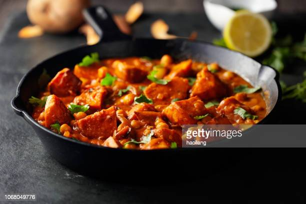 sweet potato and chickpea tikka masala - vegetarian food stock pictures, royalty-free photos & images