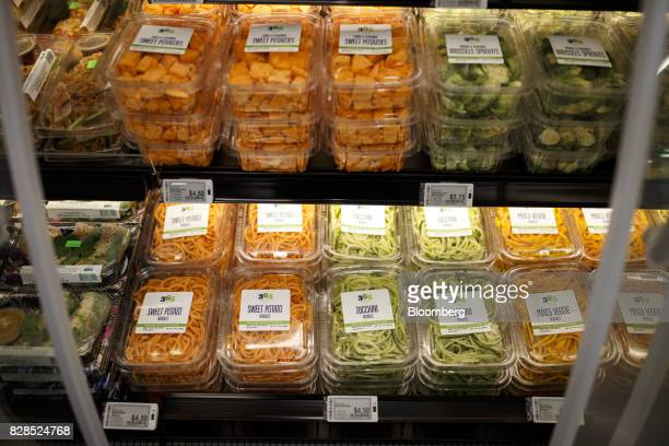Sweet potato and zucchini noodles are displayed for sale during the grand opening of a Whole Foods Market 365 location in Santa Monica California US...