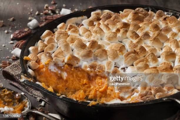 sweet potato casserole with pecans and marshmallows - sweet potato stock pictures, royalty-free photos & images