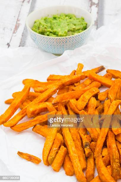 sweet potato french fries with avocado sauce - larissa veronesi stock pictures, royalty-free photos & images